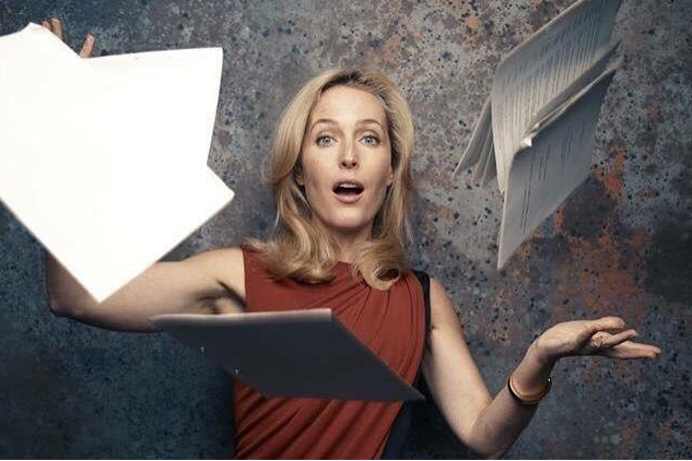 gillian throwing papers